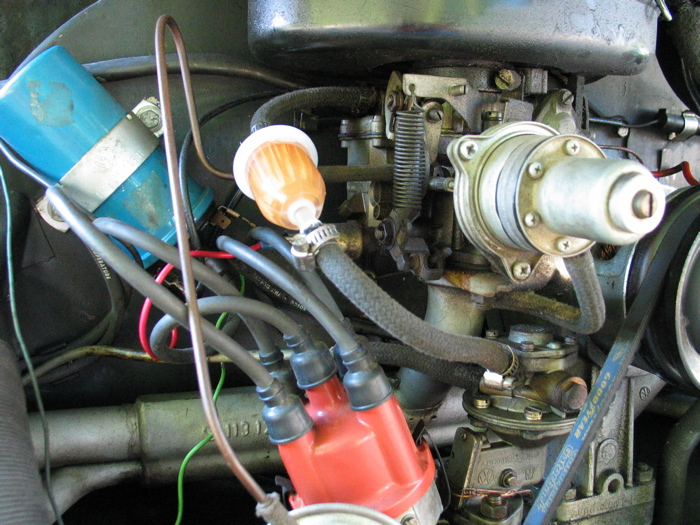 here's a better shot of what we had to contend with on the carburator side   the blue cylinder on the left is the coil, the red thing with the cool hair  on